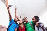 Cute pupils taking a selfie in the corridor