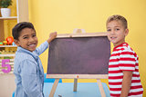 Cute little boys drawing on chalkboard