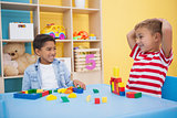 Cute little boys playing with building blocks