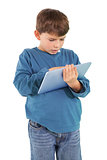 Cute little boy using tablet pc
