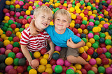Happy children playing in ball pool