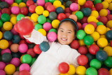 Happy girl playing in ball pool