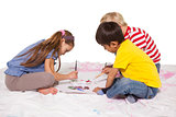 Happy little children painting on the floor