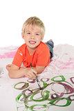 Happy little boy painting on the floor