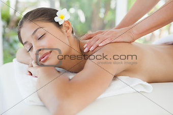 Beautiful brunette enjoying a back massage