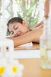 Beautiful brunette enjoying a massage