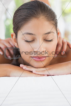 Beautiful brunette enjoying a massage