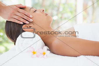 Beautiful brunette enjoying a head massage