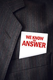 We Know The Answer business card in suit pocket