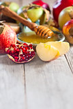 Pomegranate, apples and honey background