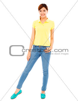 smiling asian young woman standing and hand on waist