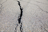 Cracked road on asphalt close up