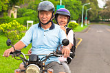 senior couple drive motorcycle to travel