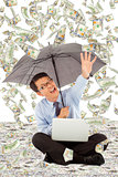 happy business man holding a umbrella and catching money