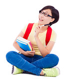 asian young student girl sitting on floor  with book