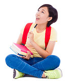 young student girl sitting on floor with book