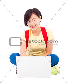 asian young student girl sitting on floor  with a laptop
