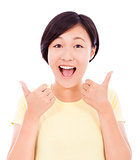cheerful  young woman standing and thumb up