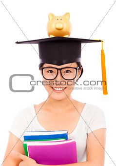 asian young student holding book with piggy bank