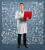 doctor male in suit with laptop in his hands