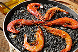 spanish arroz negro, a typical rice casserole made with squid in