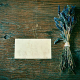 lavender flowers and blank signboard on a rustic table
