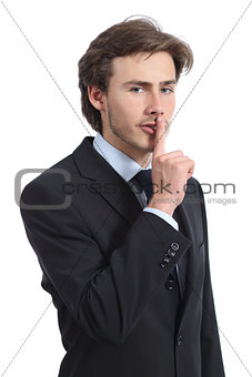 Business man asking for silence shh