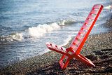 Red deck chair at the beach.