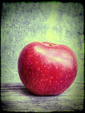 Red apple on grunge background