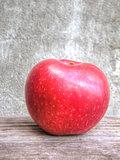Red apple on grunge background