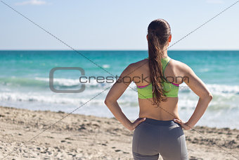 Fit woman looking at the ocean