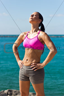 Fit woman worshiping the sun