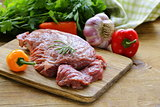 Raw beef steak with ingredients vegetables on a wooden board
