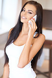 Gorgeous young woman chatting on her mobile