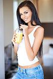 Friendly beautiful woman drinking orange juice