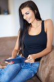 Happy attractive woman relaxing with a tablet-pc
