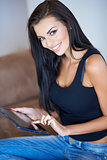 Gorgeous young woman surfing on a tablet-pc