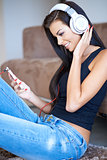 Happy young woman relaxing listening to music