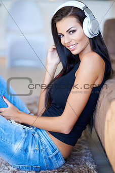 Casual young woman listening to music