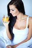 Young woman enjoying a glass of orange juice