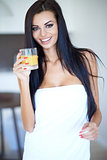Healthy young woman drinking fresh orange juice