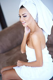 Smiling Woman Wearing White Bath Towel