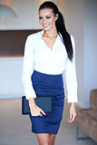 Beautiful stylish woman carrying a tablet