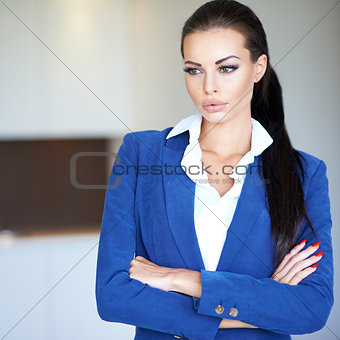 Beautiful young businesswoman deep in thought