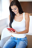Beautiful woman reading information on a tablet