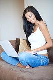 Beautiful casual young woman using a laptop
