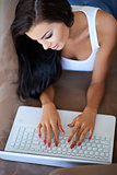 Stylish young woman working on a laptop