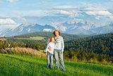 Family on summer mountain hill (Poland)