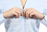 Closeup of a woman hands unbuttoning a shirt
