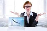 Composite image of businesswoman holding hand out in presentation